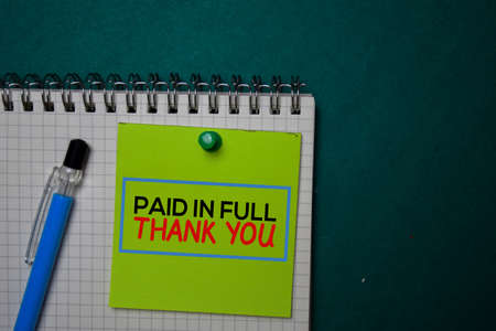 Paid in Full - Thank You write on a sticky note isolated on green background. Stockfoto