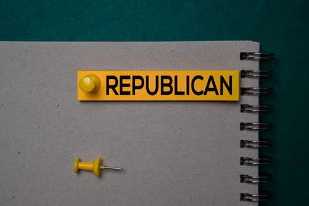 Republican write on a sticky note isolated on green background.