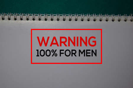 Warning 100% For Men write on a book isolated on green background.