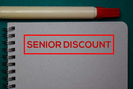 Senior Discount write on a book isolated on green background.
