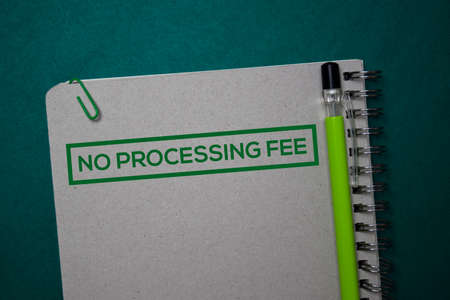 No Processing Fee write on a book isolated on green background. Stockfoto