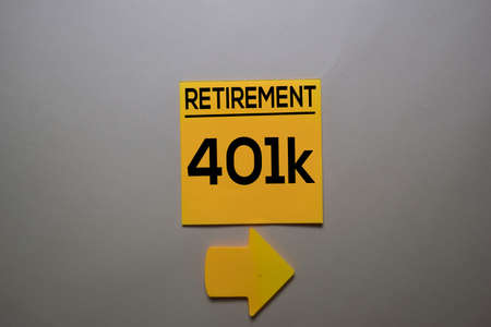 Retirement 401k write on a sticky note isolated on office desk.