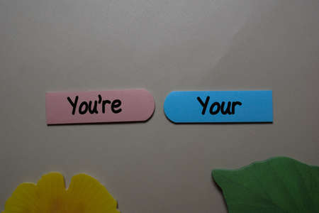 Youre, Your write on a sticky note isolated on office desk. Learning use proper grammar Reklamní fotografie