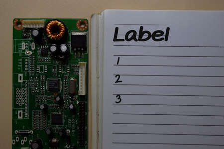 Label with number write on a book with circuit board computer isolated on office desk. Stock Photo