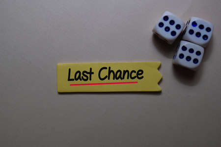 Last Chance write on a sticky note isolated on office desk.