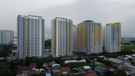Bekasi, West Java, Indonesia - January 21 2020: Aerial landscape of modern apartment building in Bekasi central business district from a drone.