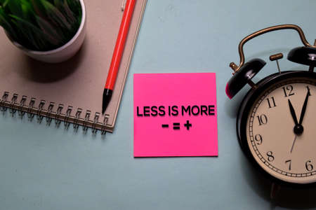 Less is More write on a sticky note isolated on office desk. Reklamní fotografie