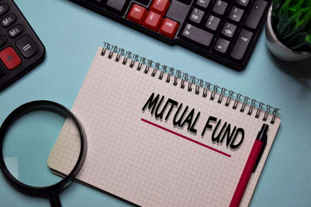 Mutual Fund write on a book isolated on office desk.