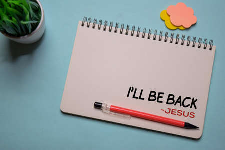 Ill Be Back - Jesus write on a book isolated on office desk. Christian faith concept