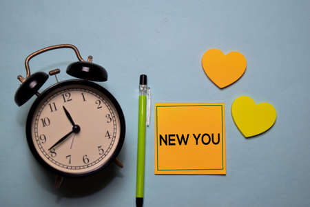 New You write on a sticky note isolated on office desk.