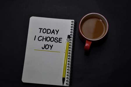 Today I Choose Joy write on a book isolated on office desk. Christian faith concept