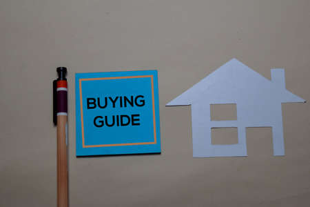 Buying Guide write on a sticky note and home made with paper isolated on office desk.