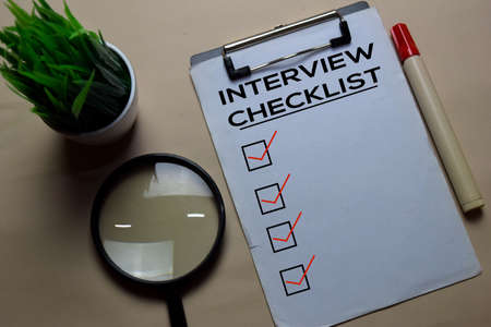 Interview Checlist write on a paperwork isolated on office desk.