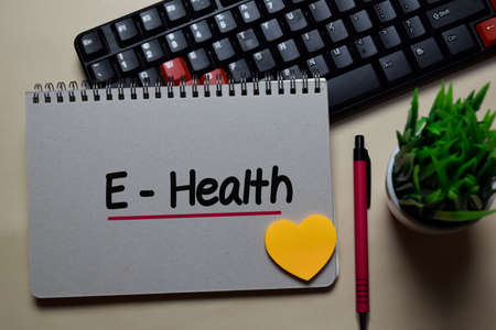 E-Health write on a book isolated on office desk.