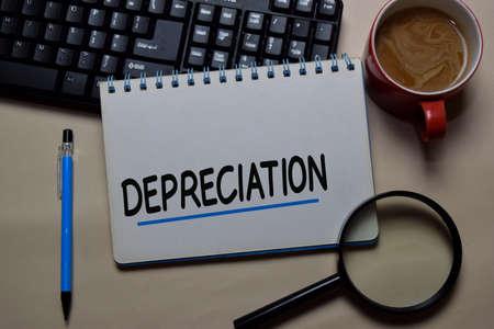 Depreciation write on a book isolated on office desk. Reklamní fotografie