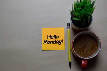 Hello Monday! write on a sticky note isolated on office desk.