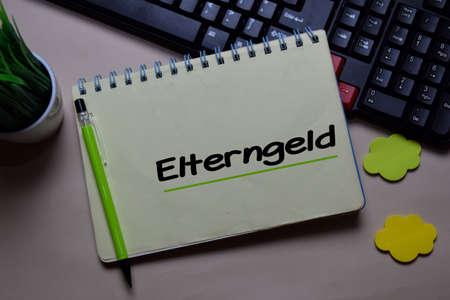 Elterngeld write on a book isolated on office desk. German Language it means Parental Benefits Reklamní fotografie