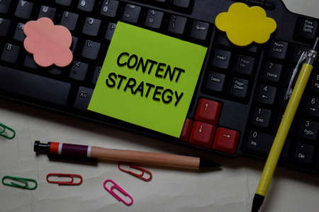 Content Strategy write on a sticky note isolated on office desk.
