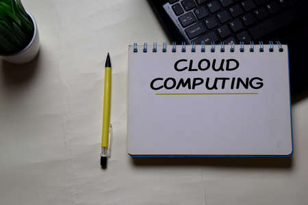 Cloud Computing write on a book isolated on office desk.