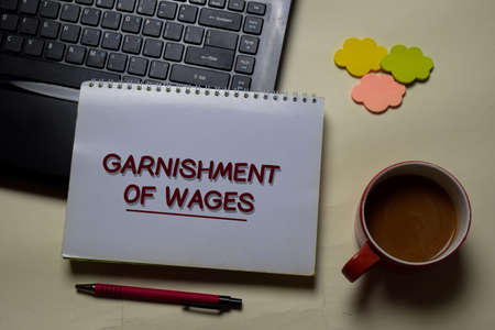Garnishment of Wages write on a book isolated on office desk. Reklamní fotografie