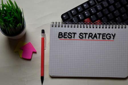 Best Strategy write on a book isolated on office desk. Reklamní fotografie