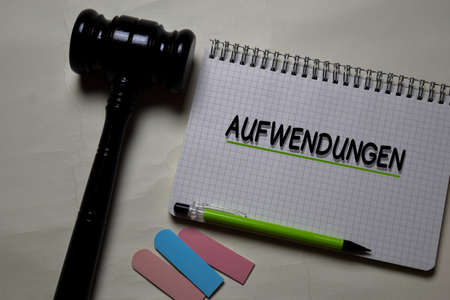 Aufwendungen write on a book with gavel isolated on Office Desk. German Language it means Operating Costs Reklamní fotografie