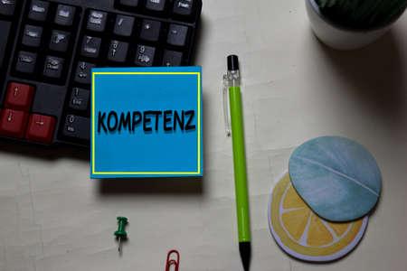 Kompetenz write on a sticky note isolated on office desk. German Language it means Competence Reklamní fotografie
