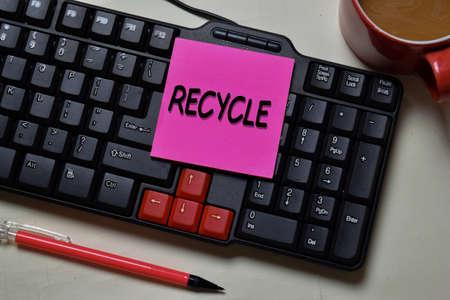 Recycle write on a sticky note isolated on office desk. Reklamní fotografie