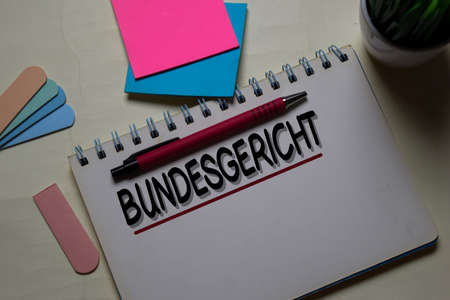 Bundesgericht write on a book isolated on office desk. German Language it means Supreme Court