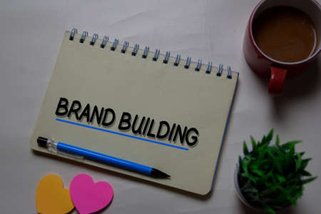 Brand Building write on a book isolated on office desk.