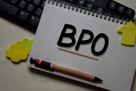 BPO - Business Process Outsourcing write on a book isolated on office desk. Reklamní fotografie