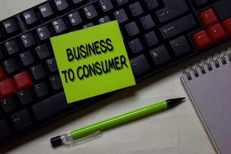 Business To Consumer write on a sticky note isolated on office desk. Reklamní fotografie
