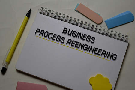 Business Process Reengineering write on a book isolated on office desk.