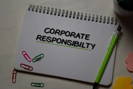 Corporate Responsibility write on a book isolated on office desk.