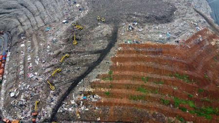 Aerial View. Large landfills like mountains. the tractor take garbage on landfills at Bekasi - Indonesia 写真素材