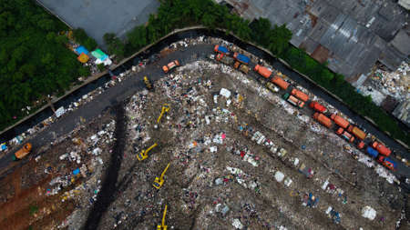 Aerial View. Large landfills like mountains. the tractor take garbage on landfills at Bekasi - Indonesia