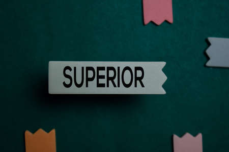 Superior write on a sticky note isolated on Office Desk