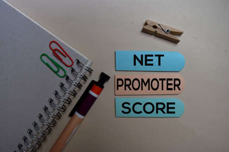 Net Promoter Score - NPS text on sticky notes isolated on office desk