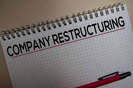 Company restructuring on book. Business and finance concept.
