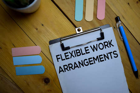 Flexible Work Arrangements write on a paperwork isolated on wooden background.