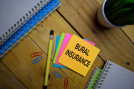 Bural Insurance write on a sticky note isolated on wooden background.