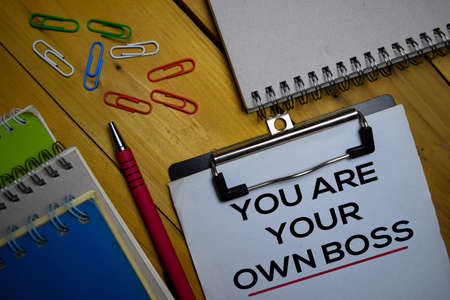 You Are Your Own Boss write on a paperwork isolated on wooden background.