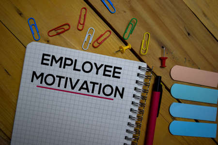 Employee Motivation write on a book isolated on wooden background.