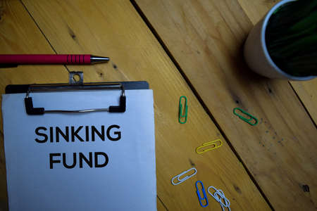Sinking Fund write on a paperwork isolated on wooden background.