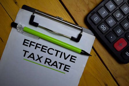Effective Tax Rate write on a paperwork isolated on wooden background. Stok Fotoğraf