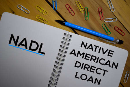 NADL - Native American Direct Loan write on a book isolated on wooden background. Stok Fotoğraf