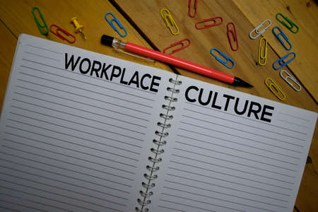 Workplace or Culture write on a book isolated on wooden background.