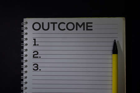 Outcome and Number write on a book isolated on Office Desk.
