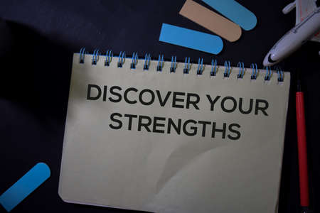 Discover Your Strengths write on a book isolated on Office Desk. Stok Fotoğraf