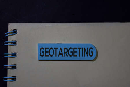 Geotargeting write on sticky note isolated on Office Desk